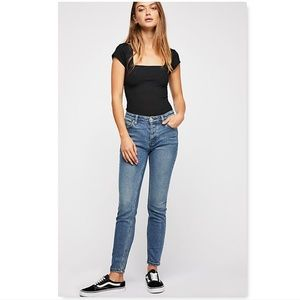 Free People mid rise button front skinny jeans